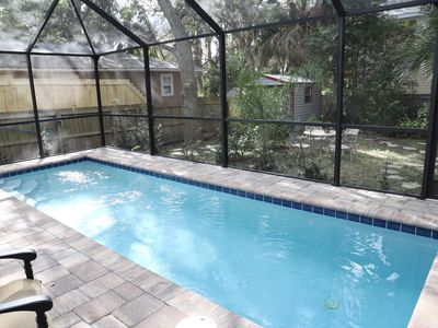 Photo for Immaculate 4BR home with private pool!  Secluded oasis!  Walk to downtown!