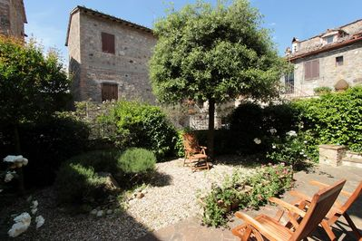 Private garden with patio, outdoor table included as well for al fresco dining.