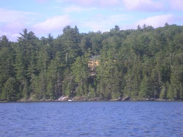Private, on the water beautiful log cabin, 815 feet of water frontage, 16 acres