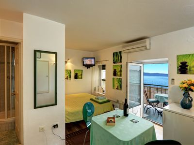Photo for Green sunny studio facing South, balcony, WiFi, TV, fully equipped
