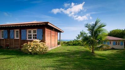 Photo for BUNGALOWS FACE THE SEA IN THE HEART OF NATURE