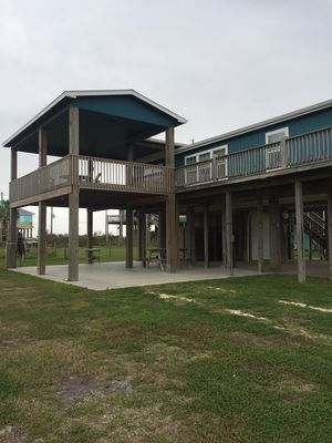 Enjoy the Gulf breezes from the covered deck