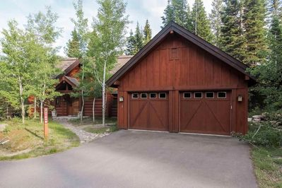 Driveway and 2-car garage in front of chalet