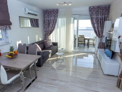 Photo for Luxury Three-Bedroom Residence with Terrace and Sea View