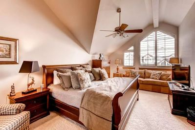 Kick back and relax in the luxurious master bedroom. Bedding configurations vary.