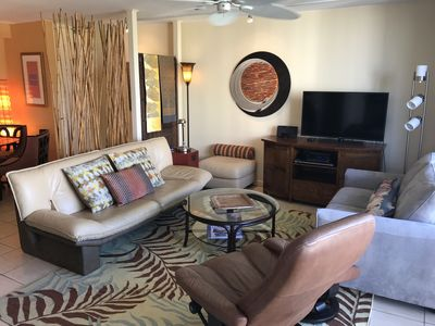 Living room: leather furniture, loveseat opens to twin bed