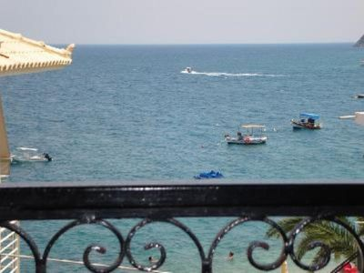 Photo for SEAFRONT APARTMENT, JUST 10 METERS FROM THE BEACH