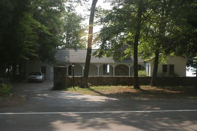 View of cottage from the road; nestled right along scenic M-22