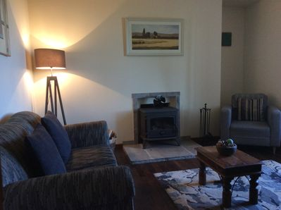 Comfortable Lounge with log burner, sofa 2 armschairs, tv with English freeview