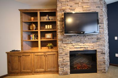 Stone electric fireplace w/Flat screen TV and built in
