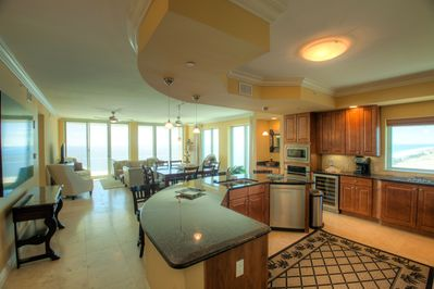 This Luxury Unit Features Granite, GE Monogram Stainless Steel Appliances, Natural Stone Floors
