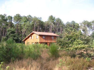 Photo for Recent wooden house between ocean and forest for 7 people