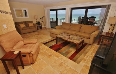 Spacious living room area with amazing beach views