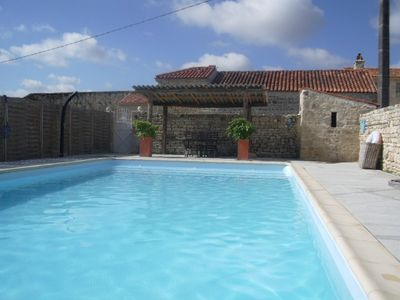 Enclosed 11x5m salt water swimming pool with roman steps in the shallow end.