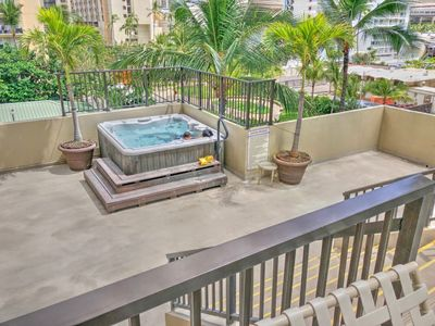 Photo for Across from Ritz Carlton | Walking distance to the  beach| Parking |washer/dryer in unit/wifi/upgraded!