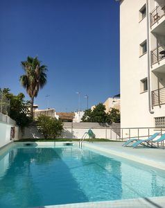 Photo for Contemporary  apartment with sea views, pool, just 100m from Pine Walk and beach
