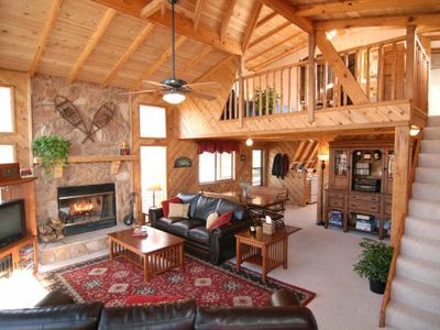 Photo for Gorgeous Lakefront Chalet w/ 450 sq ft Private Beach, Campfire Pit, Dock & Boats