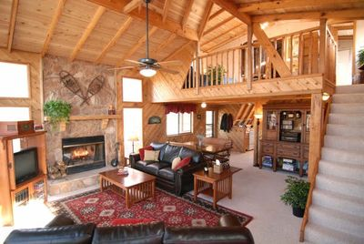Relax in our rustic Great Room with working fireplace.