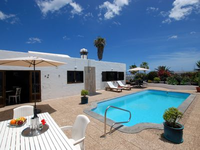 Photo for Typical Canarian House with heated pool next to the ocean!