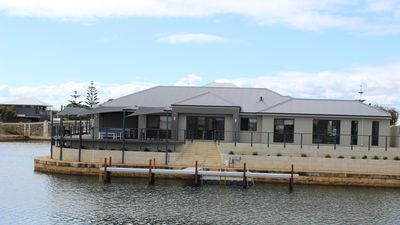 Photo for Port Bouvard Retreat - Large family friendly canal home with private jetty
