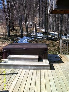 Large Hot tub and deck for lounging and enjoying the fabulous views