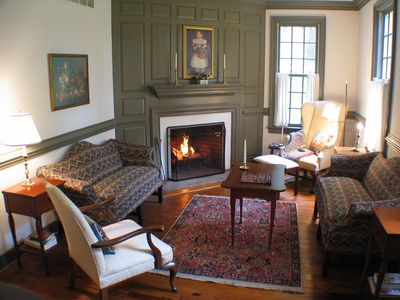 The front parlor, with views of the river, is furnished in 18th-century style.