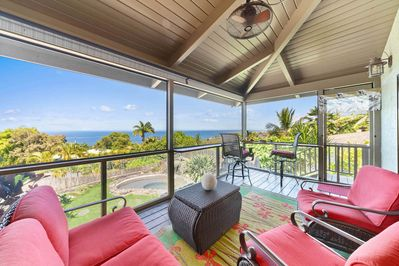 Lanai with ocean view and wicker seating with red cushions