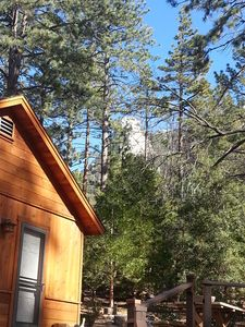 You can sit on the deck, enjoy a cup of coffee or glass of wine, and gaze at Lily Rock.