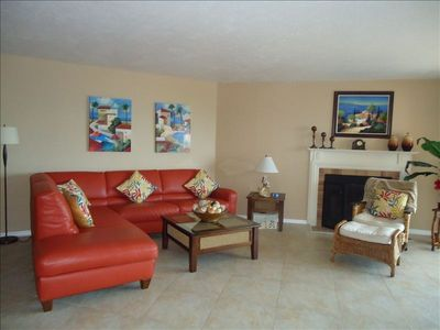 Spacious Living Room with fireplace, 52' flat tv. Sliding doors open to balcony.