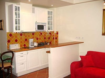 Well equipped kitchen with adjoining living area