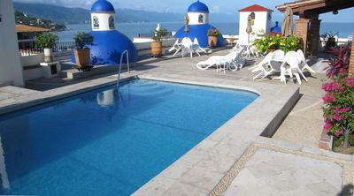 The roof top pool has plenty of lounge chairs and a frig for your drinks