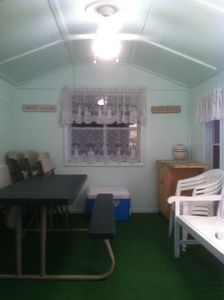 Inside Cabana. A cooler provided and beach cart is stored here.