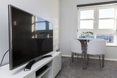 4K TV and dining area