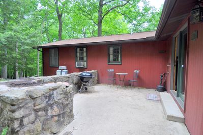 Front porch has a charcoal grill and BBQ pit.