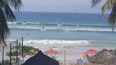 Check out the surfer doing a headstand.  Taken from our patio