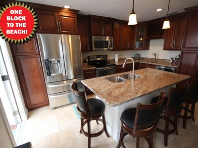 Discounted rates, very nicely updated & just one block from the beach!