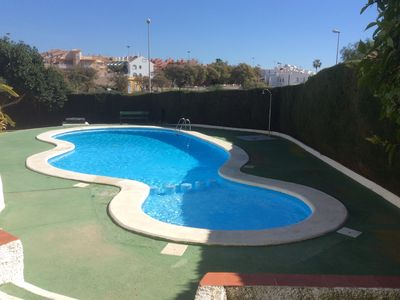 Photo for Charming one bedroom garden apartment with communal pool, close to sandy beaches
