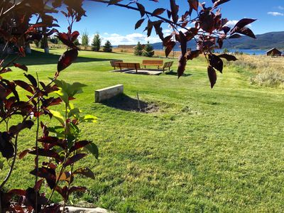 Fire pit and horseshoe pit overlooking the lake. Over an acre of grass to play
