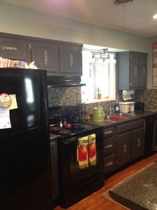 Full kitchen with eating bar and open to living room