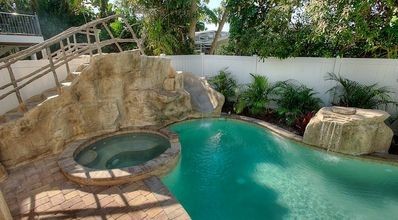 Photo for BEAUTIFUL 6 BEDROOM! SHORT WALK TO BEACH POOL SPA AND WATER SLIDE!!! BOOK YOUR 2020 STAY TODAY!