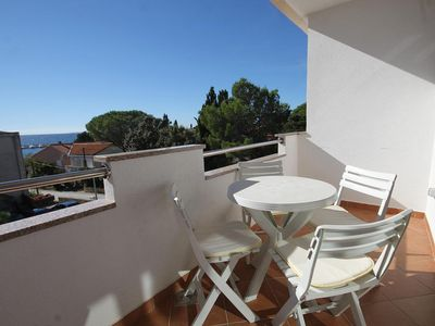 Photo for One bedroom apartment with terrace and sea view Novalja (Pag) (A-9349-a)