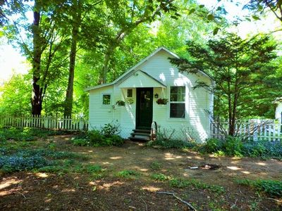 Photo for This remarkable cottage is in a serene setting yet you can walk to downtown!
