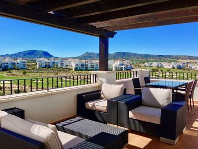 Photo for Penthouse apartment with frontline golf, pool and mountain views