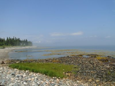 Long view of the beach, a sunny day with fog on the western half of the island.