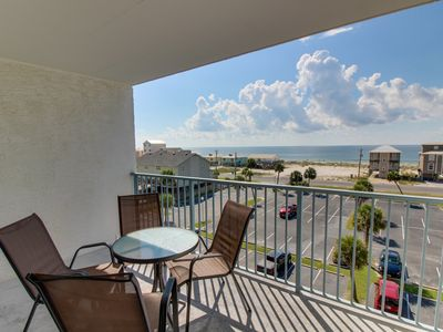 Photo for NEW LISTING! Waterfront condo w/ shared pool & hot tub - across road from beach