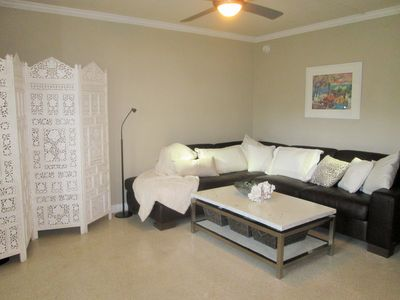 spacious, comfortable living room, leather sectional.