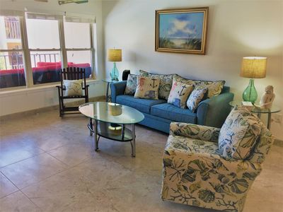 Photo for Magnificent 2 bedroom 2 bath condo facing a tropical garden / large swimming pool.