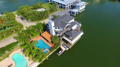 Photo for Something for everyone!..Pool, Boat Space, water toys, bar and grill. Spacious