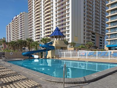 Photo for Spacious Condo Steps from the Beach w/ WiFi, Resort Pools, Water Slide & More!