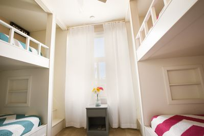 Bunkroom has four built-in sleeping compartments, each with a full size bed